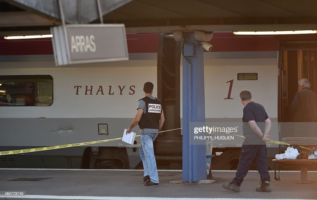 A crime investigator walks next to a Thalys train of French national railway operator SNCF at the main train station in Arras northern France on...