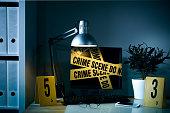Computer monitor and Crime scene tape. Cybercrime or financial crime concept.