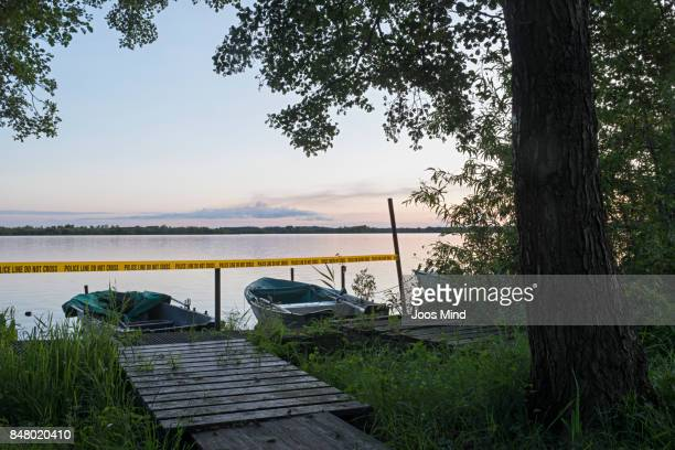 crime scene at a lake in the evening