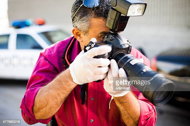 Crime Scene Investigator Taking Photograph