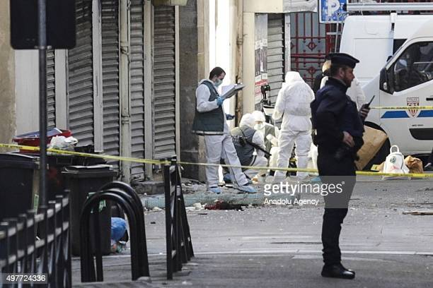 Crime scene investigators are seen on duty after an operation against terrorists in Saint Denis a northern suburb of Paris on November 18 2015...