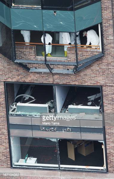 Crime scene investigators continue to inspect buildings near the scene of the Boston Marathon bombings on the day after the second suspect was...