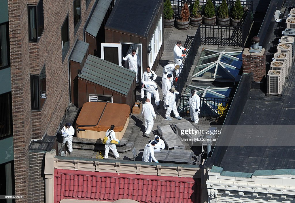 Crime scene investigators inspect a rooftop above the sight of a bombing on Boylston Street April 18, 2013 in Boston, Massachusetts. Investigators continue to work the scene of a two-bomb explosion at the finish line of the marathon that killed 3 people and injured more than 170 others.