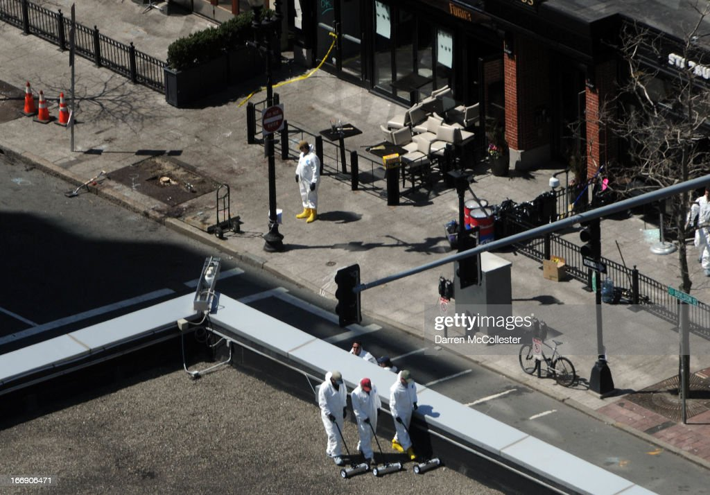 Crime scene investigators inspect the roof of Lord & Taylor near a camera mount above the sight of the marathon finish line bombing April 18, 2013 in Boston, Massachusetts. Multiple sources claim this camera captured footage of great significance to the investigation. Investigators continue to work the scene of a two-bomb explosion at the finish line of the marathon that killed 3 people and injured more than 170 others.