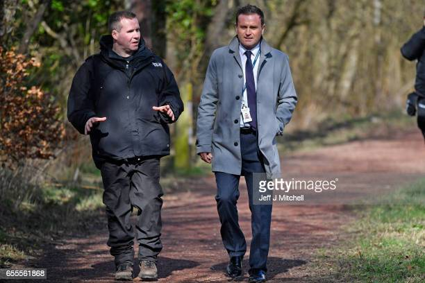 Crime scene manager Detective sergeant John Lewis and Detective superintendent Pat Campbell watch as Police Scotland divers search a canal stretch...
