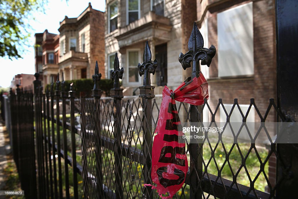 Crime scene tape hangs from a fence near the location where 21-year-old Ronald Baskin was shot and killed Sunday afternoon on May 13, 2013 in Chicago, Illinois. Three people were shot and killed and at least six others were wounded in gun violence in the city this past weekend. Chicago Police Superintendent Garry McCarthy held a press conference today to announce his department had seized more that 2,500 illegal firearms in the city so far this year.