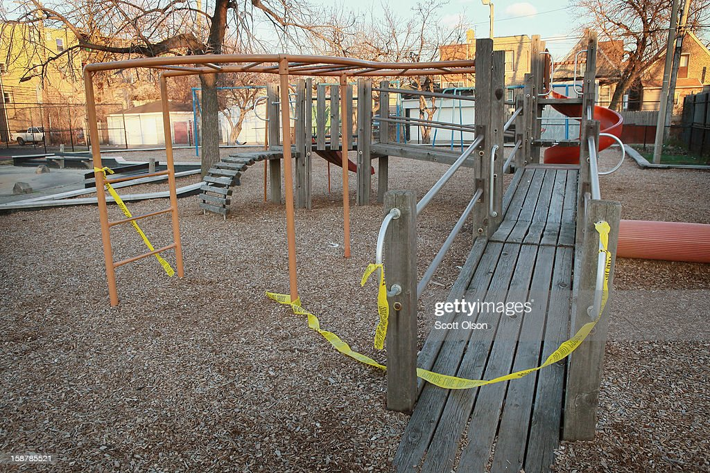 Crime scene tape hangs from the playground equipmemt where 16-year-old Jeffrey Stewart collapsed after being shot on December 9, in the Humboldt Park neighborhood on city's West Side December 11, 2012 in Chicago, Illinois. Stewart was shot about a block away then ran to the play lot where he collapsed. Stewart was shot along with 17-year-old Anton Reed who survived with a gunshot wound to the hand. Reed was later arrested after vomiting three baggies of what appeared to be cocaine. On December 28, 2012, after news organizations began reporting about what was believed to be the 500th murder in Chicago this year, the Chicago Police Department's News Affairs Office issued a statement stating the city's murder total remains at 499 because classification of one death investigation remains pending. They would not specify which death is pending. The total number of murders in the city has only once exceeded 500 victims since 2004. The murder rate is up about 11 percent from 2011, much of which is attributed to growing gang violence.