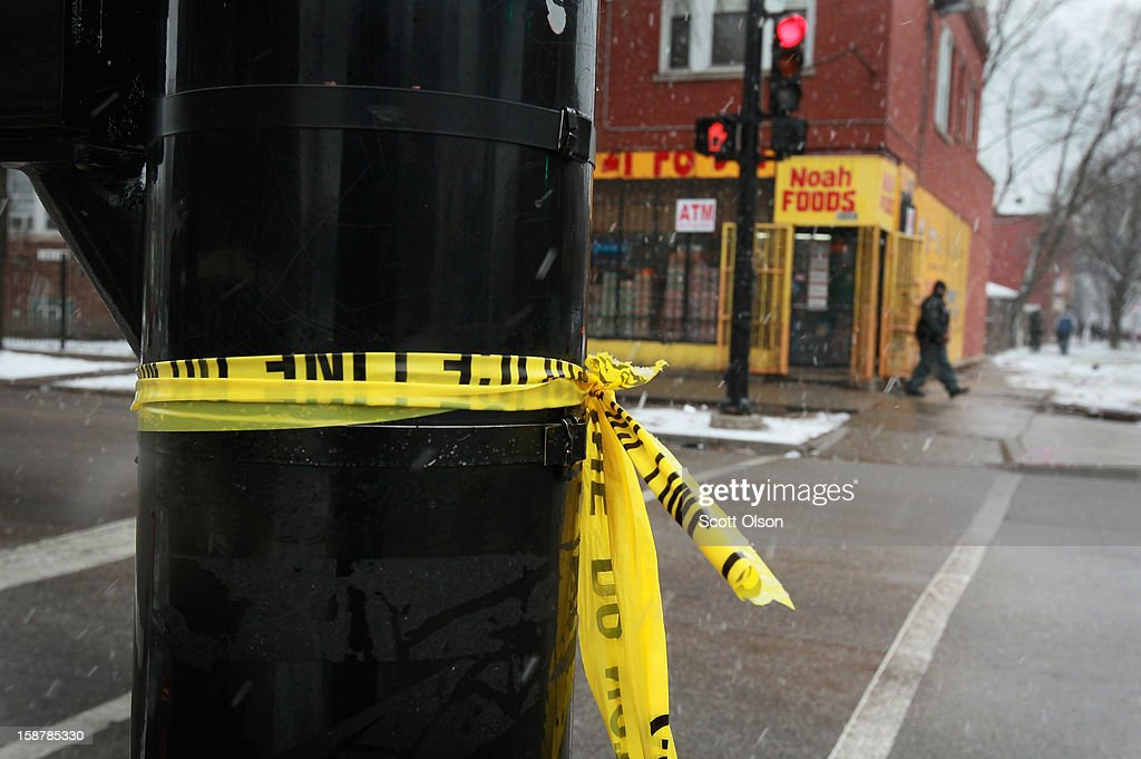 Crime scene tape hangs on a light pole across from Noah Foods December 28, 2012 in Chicago, Illinois. Nathaniel Jackson, believed to be the 500th murder victim of the year in Chicago, was shot in the head and killed outside the store on December 27. After news organizations began reporting about his murder, the Chicago Police Department's News Affairs Office issued a statement stating Chicago's murder total remains at 499 because classification of one death investigation remains pending. They would not specify which death is pending. The total number of murders in the city has only once exceeded 500 victims since 2004. The murder rate is up about 11 percent from 2011, much of which is attributed to growing gang violence.