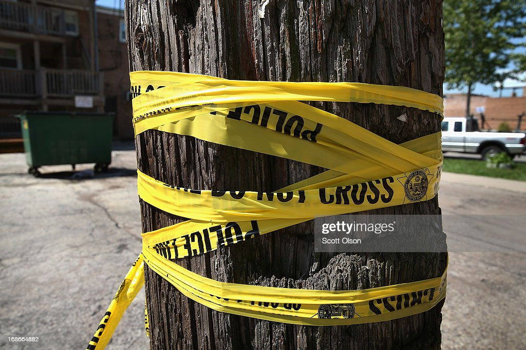 Crime scene tape is wrapped around a power pole near the location where a 20-year-old man died from a gunshot wound to the head and a 15-year-old boy was shot and wounded during weekend violence on May 13, 2013 in Chicago, Illinois. Three people were shot and killed and at least six others were wounded in gun violence in the city this past weekend. Chicago Police Superintendent Garry McCarthy held a press conference today to announce his department had seized more than 2,500 illegal firearms in the city so far this year.