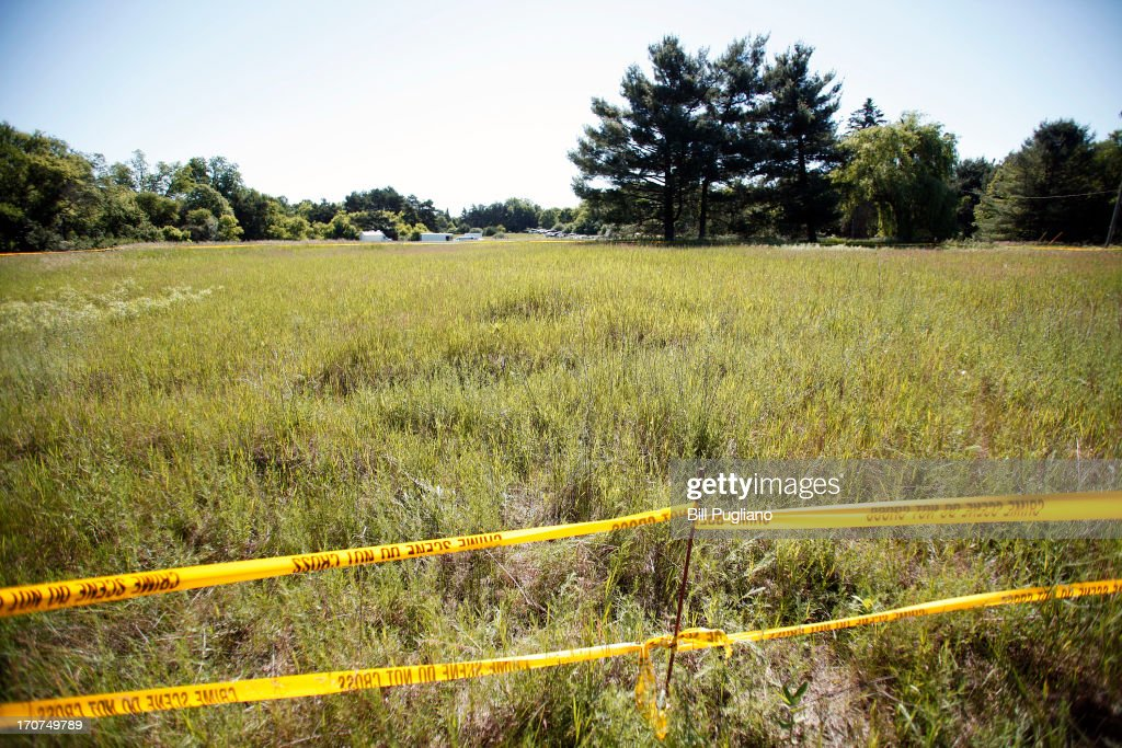 Crime scene tape marks the area beyond which news media may not go where FBI agents search a field (background) outside Detroit for the alleged remains of former Teamsters' union president Jimmy Hoffa June 17, 2013 in Oakland Township, Michigan. The agents were acting on a tip provided by Tony Zerilli, 85, a former mobster, who was released from prison in 2008. Hoffa, who had reported ties to organized crime, went missing in July of 1975.