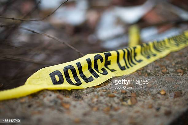 Crime scene tape remains in the rubble of a business that was destroyed during November rioting on March 13 2015 in Dellwood Missouri The rioting...