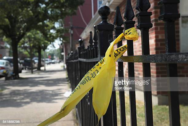 Crime scene tape remains on a fence near Holy Cross Church where Salvador Suarez was gunned down Sunday as services were ending June 20 2016 in...