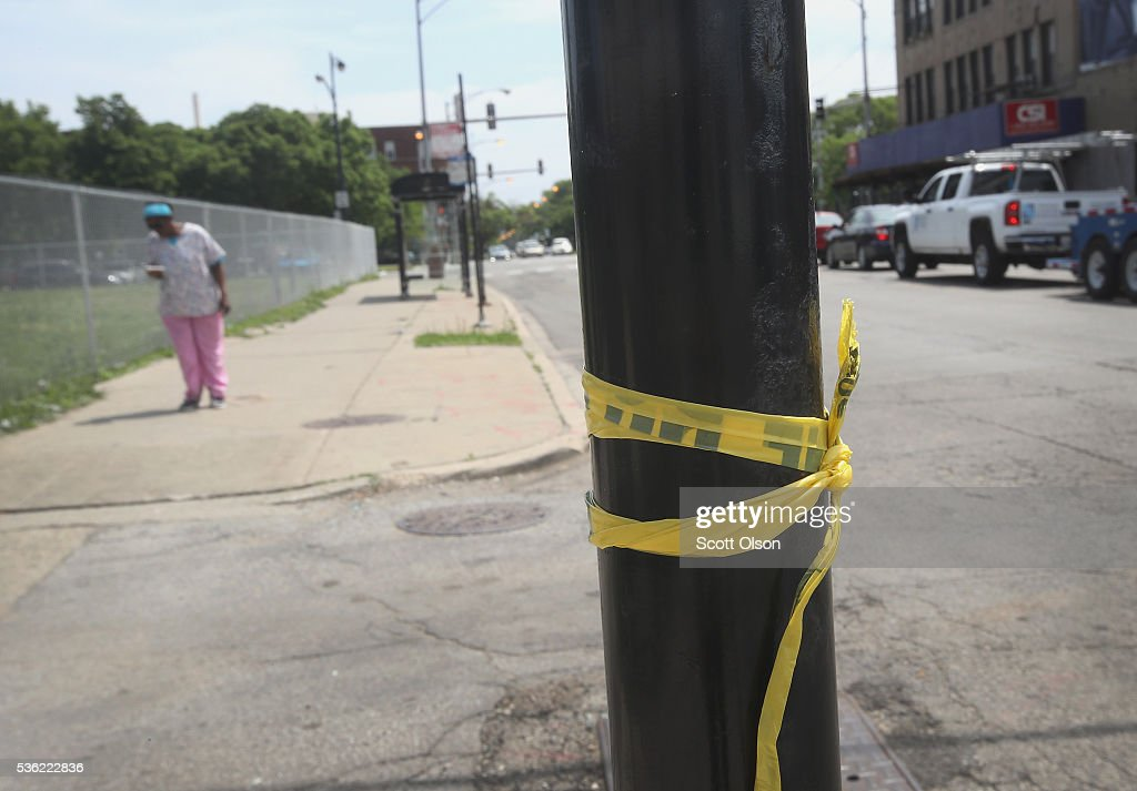 Crime scene tape remains on a light pole in the Washington Park neighborhood near where a man was shot and killed monday evening on May 31, 2016 in Chicago, Illinois. The man was one of 69 people shot in the city over the Memorial Day weekend, with at least six dying from their injuries.