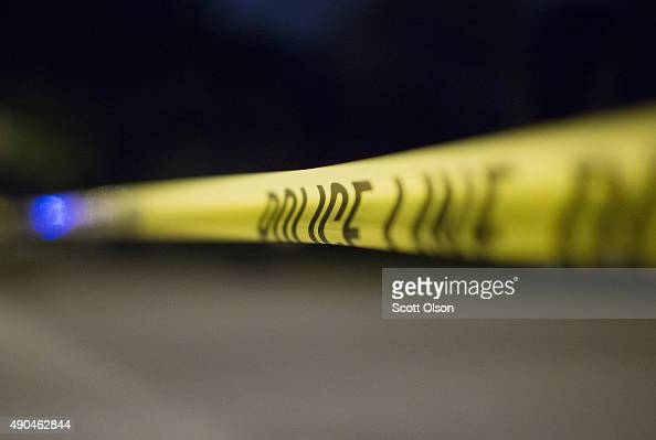 Crime scene tape secures a shooting scene where 5 people were reported to have been shot including an 11monthold infant on September 28 2015 in...