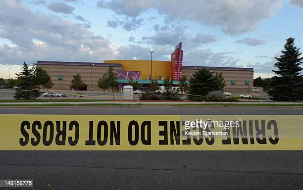 Crime scene tape surrounds the Century 16 movie theater where 12 people were killed in a shooting rampage last Friday on July 23 2012 in Aurora...