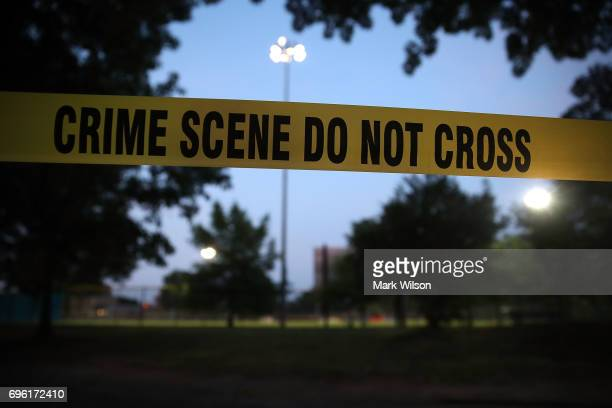 Crime scene tape surrounds the Eugene Simpson Field the site where a gunman opened fire June 15 2017 in Alexandria Virginia Multiple injuries were...
