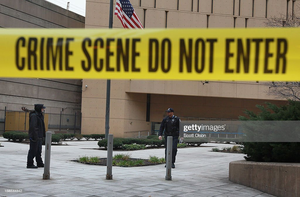 Crime scene tape surrounds the federal Metropolitan Correctional Center in the Loop after two convicted bank robbers escaped on December 18, 2012 in Chicago, Illinois. Joseph 'Jose' Banks and Ken Conley appear to have busted away concrete to enlarge a window opening then climbed down about 16 stories on makeshift ropes on the outside of the building. Banks, known as the Second-Hand Bandit, was convicted last week of two bank robberies and two attempted robberies where he made off with a nearly $600,000, $500,000 of which is still unaccounted for. Conley was convicted of robbing nearly $4,000 from a bank last year.