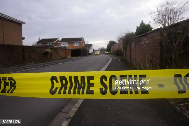 Crime Scene yellow tape is placed across a street at a scene in Beatty Way Burnham on Sea in Somerset where a man was arrested under the Explosives...