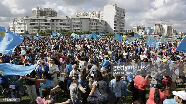 Crimean Tatar celebrate a day of their national flag in the Crimean capital Simferopol on June 26 2014 Crimea's largely Russianspeaking residents...