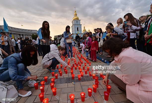 Crimean Tatars light candles during a memorial ceremony in Kiev on May 17 held on the 70th anniversary of the deportation of Tatars from Crimea...