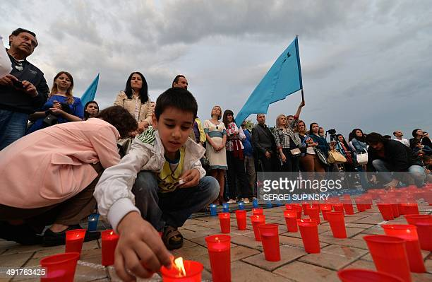 Crimean Tatars light candles during a memorial ceremony marking the 70th anniversary of the deportation of Tatars from Crimea in Kiev on May 17 2014...