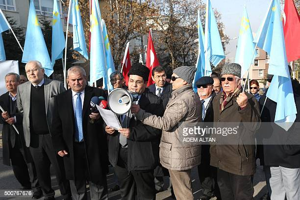 Crimean Tatars living in Turkey hold flags during a protest to call for human rights and the liberation of political prisoners in Crimea on December...