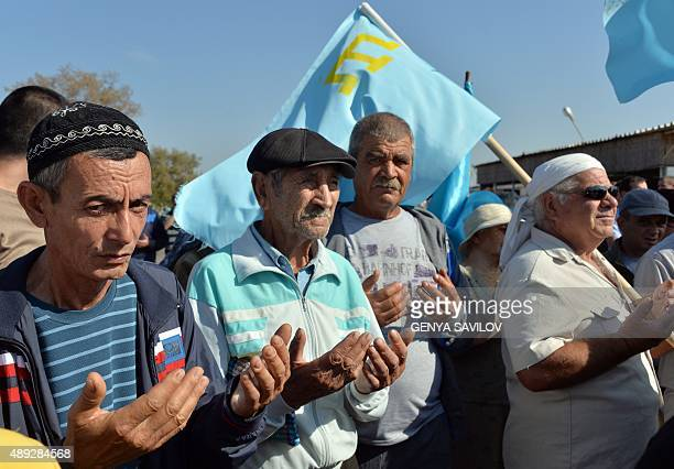 Crimean Tatars pray as they block the road at the checkpoint between Ukraine and Crimea in Chongar on September 20 2015 Hundreds of representatives...