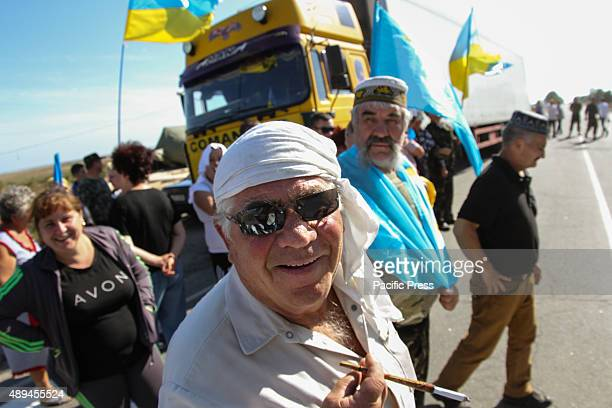 Crimean Tatars togather with activists of nationalistic movements block the entry of lorries at border crossing point 'Chonhar' on the administrative...