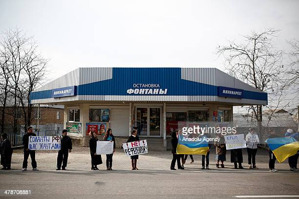 Crimean tatars wave Ukraine's national flag as they gather to protest the upcoming referendum scheduled for March 16 to join Russia in Sevastopol...
