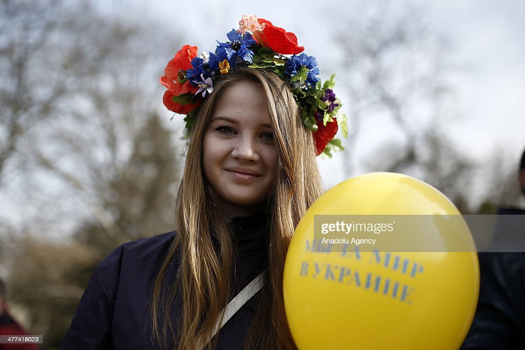 Crimean who supports Ukraine sing an anthem in Crimea, Ukraine, on March 9, 2014. Protestors hold a public demonstration due to support Russia and Ukraine during the preparation of referendum in Crimea, Ukraine, on March 9, 2014. Crimeans who support Russia shout slogans in Lenin Square.