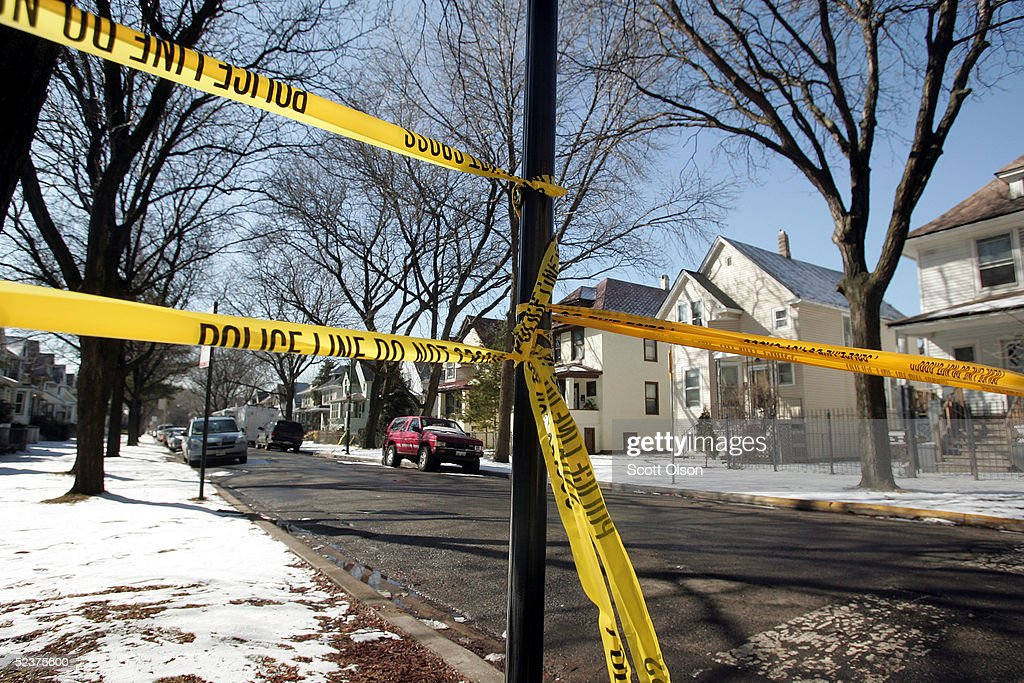 Crime-scene tape stops all but the residents at the end of the block where murder suspect Bart Ross lived on the city's northwest side March 11, 2005 in Chicago, Illinois. A note claiming responsibility for the February 28 murders of Michael Lefkow and Donna Humphrey, the husband and mother of United States District Judge Joan Lefkow was found in Ross? car following his suicide after police stopped his car last night in Wisconsin.