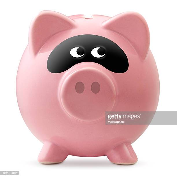 Criminal activity. Piggy bank with a bandit mask