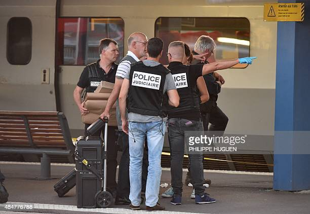 Criminal and forensic investigators are seen on a platform next to a Thalys train of French national railway operator SNCF at the main train station...