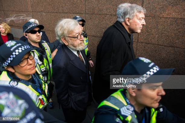 Criminal barrister Robert Richter QC and Cardinal George Pell arrive for court hearing at the Melbourne Magistrates Court in Melbourne Australia on...