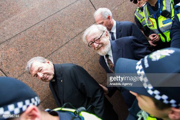 Criminal barrister Robert Richter QC and Cardinal George Pell leave after court hearing at the Melbourne Magistrates Court in Melbourne Australia on...