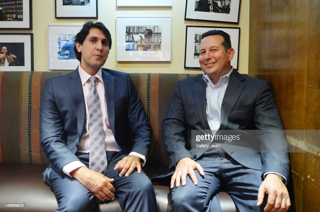 Criminal defense attorney Jose Baez (R) and <a gi-track='captionPersonalityLinkClicked' href=/galleries/search?phrase=Juan+Gonzalez&family=editorial&specificpeople=204169 ng-click='$event.stopPropagation()'>Juan Gonzalez</a> signs copies of Jose Baez book 'Presumed Guilty: Casey Anthony: The Inside Story at Books and Books on July 30, 2012 in Coral Gables, Florida.