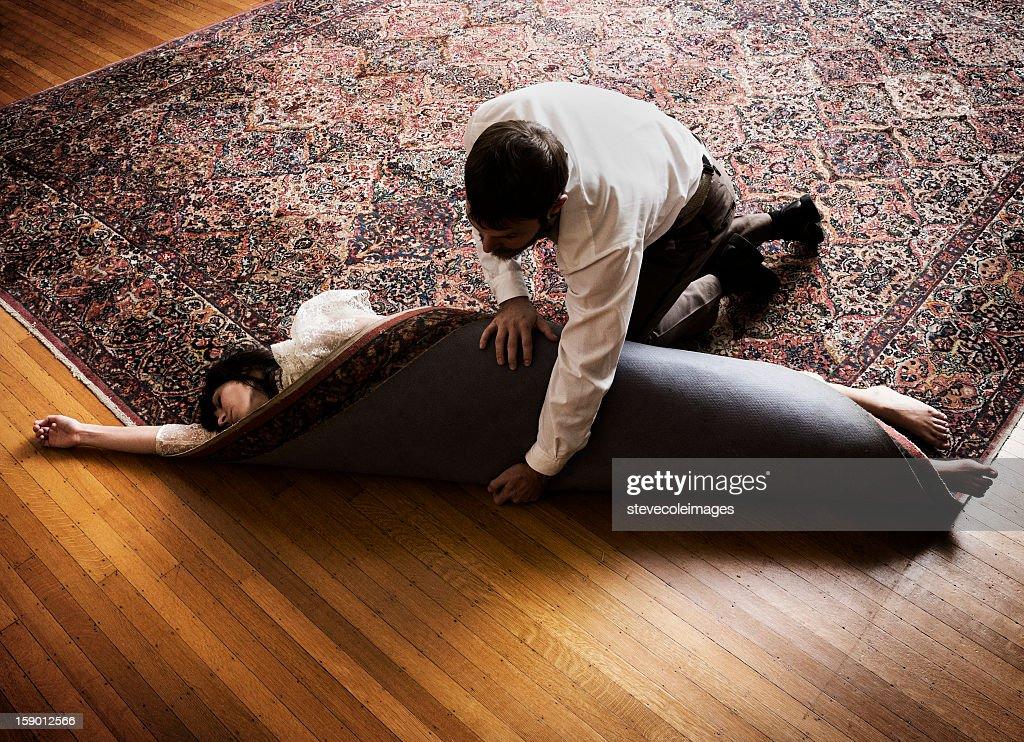 Criminal Hiding Dead Body In Carpet. : Stock Photo