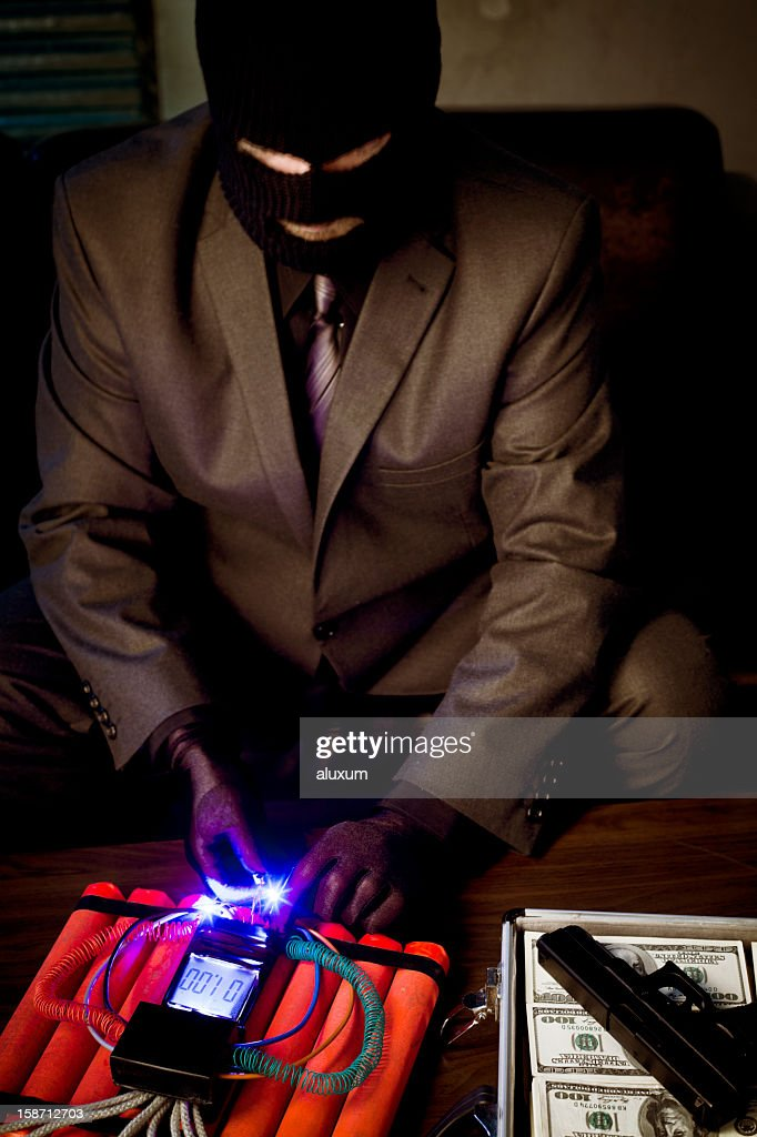 Criminal with time bomb : Stock Photo