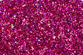 Crimson glitter shiny background. High resolution photo.