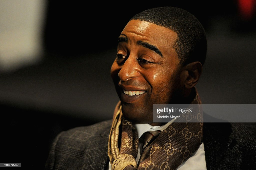Cris Carter, former NFL player, and current ESPN analyst, talks with reporters during the ESPN media availablility in the Empire West Ballroom, at Super Bowl XLVIII Media Center at the Sheraton New York Times Square on January 28, 2014 in New York, New York.