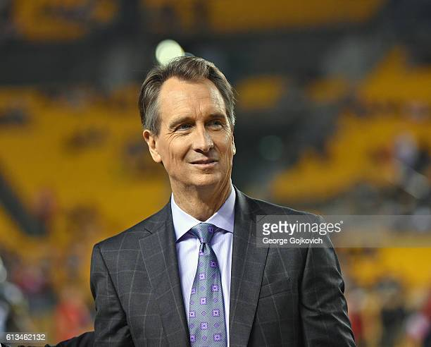 Cris Collinsworth NBC Sports Sunday Night Football announcer looks on from the sideline before a game between the Kansas City Chiefs and Pittsburgh...