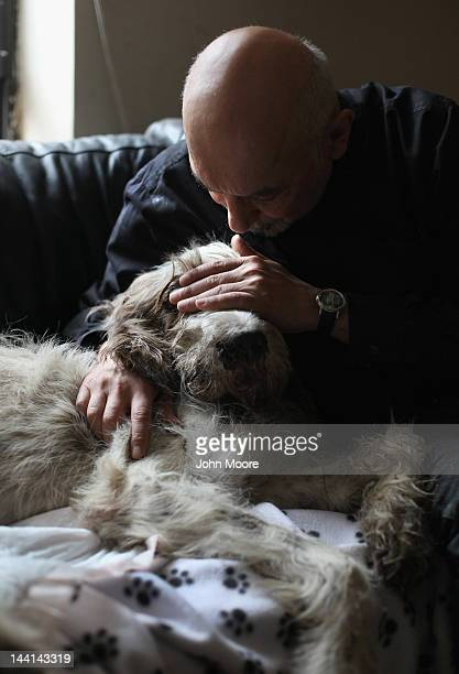 Cris Cristofaro covers his dog Dino's eyes as he is sedated by veterinarian Wendy McCulloch during an inhome pet euthanasia on May 9 2012 in New York...