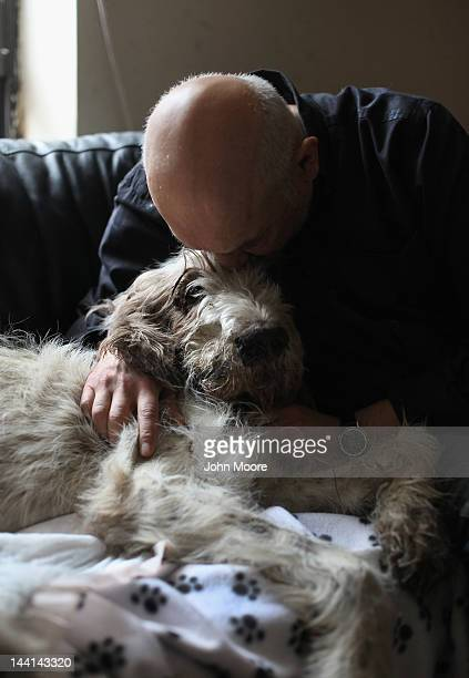 Cris Cristofaro kisses his dog Dino as he is sedated by veterinarian Wendy McCulloch during an inhome pet euthanasia on May 9 2012 in New York City...