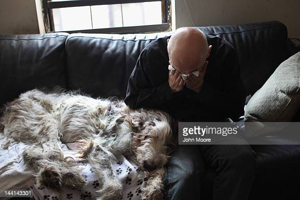 Cris Cristofaro weeps over his dog Dino after veterinarian Wendy McCulloch euthanized the 12yearold Italian Spinone on May 9 2012 in New York City...