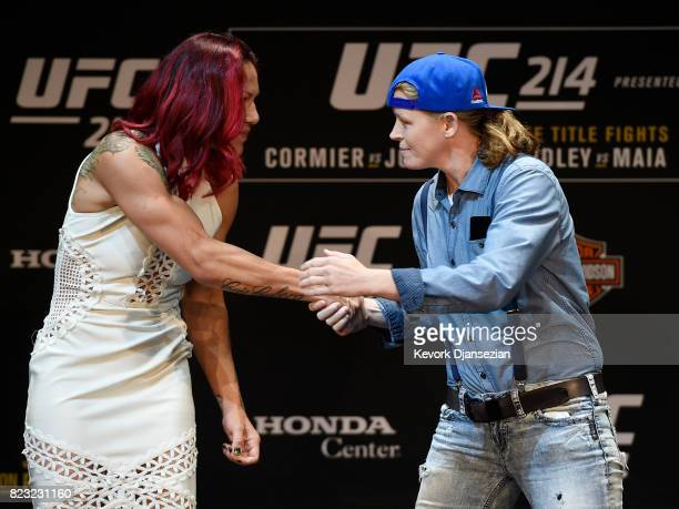 Cris Cyborg and Tonya Evingeras shake hands after they faced off during the UFC 214 Press Conference at The Novo by Microsoft July 26 in Los Angeles...