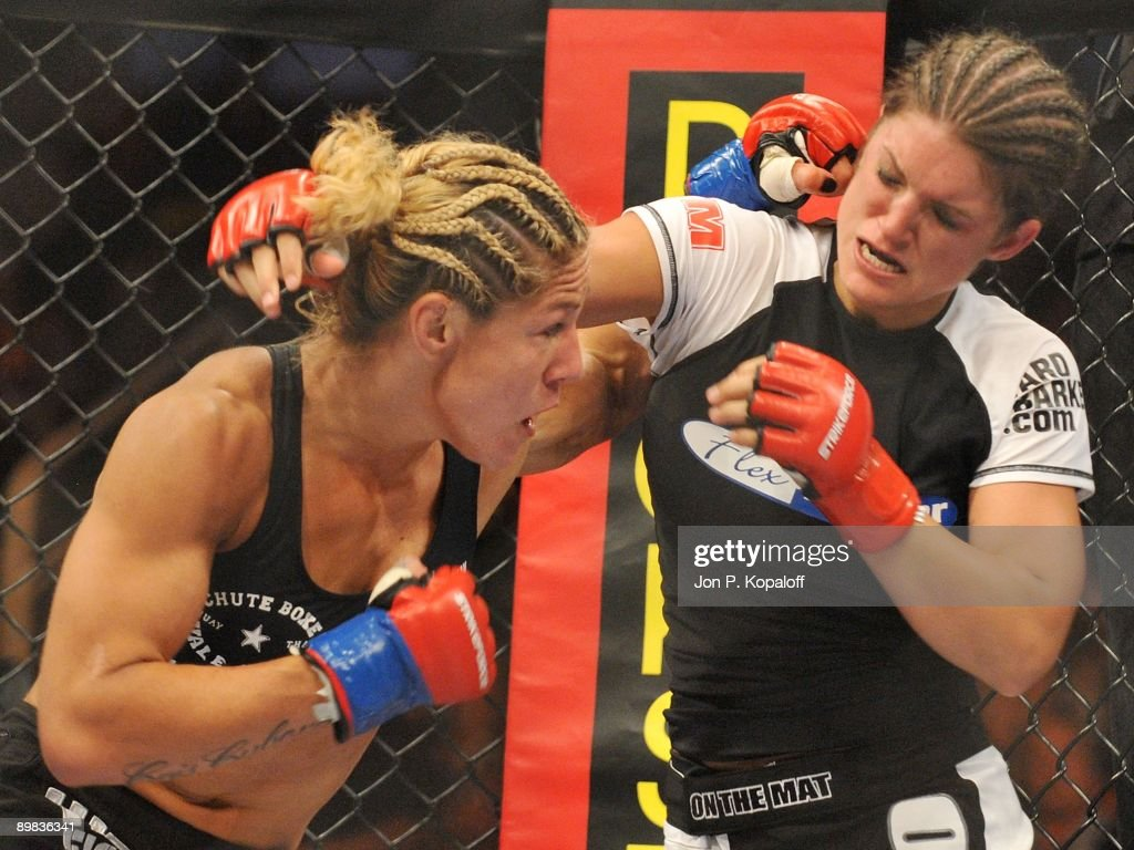 Cris Cyborg (L) battles Gina Carano during their Middleweight Championship fight at Strikeforce: Carano vs. Cyborg on August 15, 2009 in San Jose, California.
