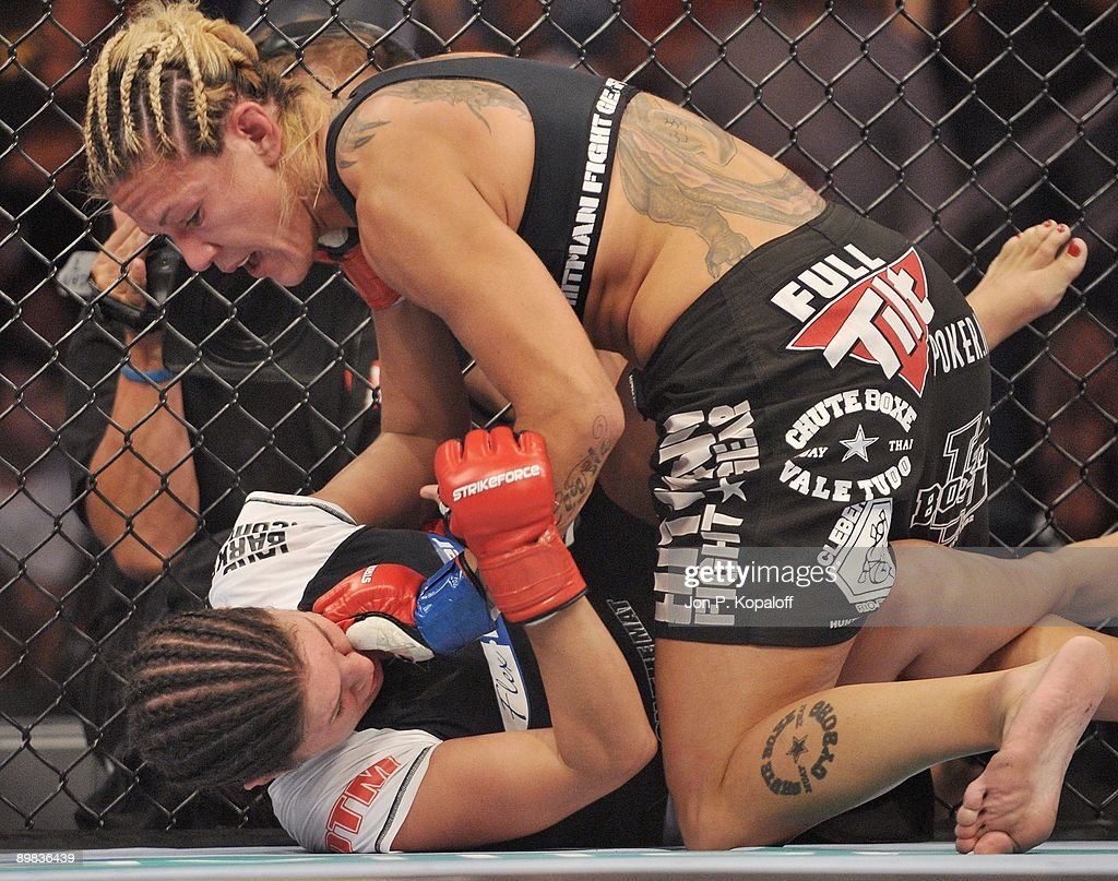 Cris Cyborg (Top) battles Gina Carano during their Middleweight Championship fight at Strikeforce: Carano vs. Cyborg on August 15, 2009 in San Jose, California.