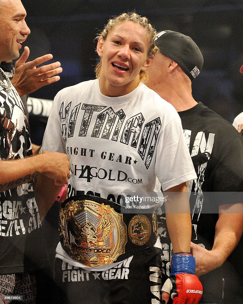Cris Cyborg celebrates after defeating Gina Carano during their Middleweight Championship Title fight at Stikeforce: Carano vs. Cyborg on August 15, 2009 in San Jose, California.