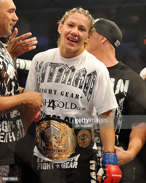 Cris Cyborg celebrates after defeating Gina Carano during their Middleweight Championship Title fight at Stikeforce Carano vs Cyborg on August 15...
