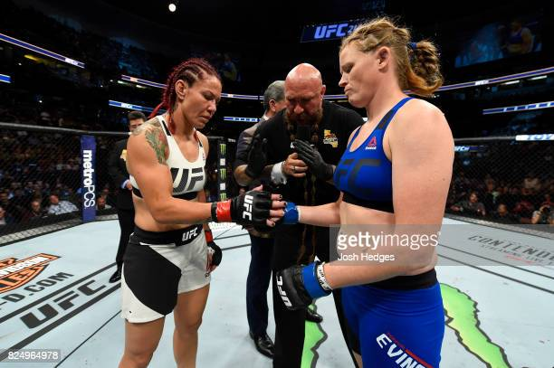 Cris Cyborg of Brazil and Tonya Evinger touch gloves before their UFC women's featherweight championship bout during the UFC 214 event inside the...